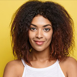 headshot-portrait-of-beautiful-attractive-african-american-woman-posting-crossed-arms-with-happy-smiling-yellow-studio-background-copy-space_1258-956.jpg